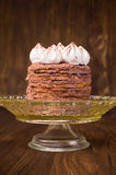 Layer cake with cocoa on a stand Stock Photo