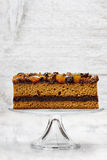 Layer cake decorated with dried fruits and honey Stock Photo