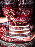 Layer cake in female hands. Layer cake on white plate in female hands. Style rustic Royalty Free Stock Photo