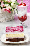Layer cake with pink icing Royalty Free Stock Image