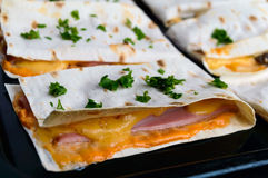 Layer Cake (pizza) from a thin pita, stuffed with sausage, cheese sauce Stock Photo