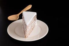 Layer cake chocolate. Layer cake white and chocolate on black background Stock Image