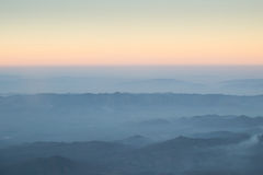 Layer of clouds fog mountain and sunrise. Royalty Free Stock Photos