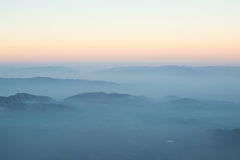 Layer of clouds fog mountain and sunrise. Royalty Free Stock Images