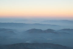 Layer of clouds fog mountain and sunrise. Royalty Free Stock Image