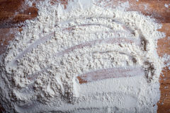 Layer of flour with chaotic pattern on cutting board Stock Photos