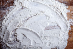 Layer of flour with chaotic pattern on  cutting board Stock Images