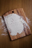 Layer of flour on cutting board Stock Photos