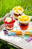 Layer fruit desserts on wooden tray Stock Photo
