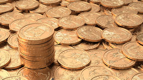 Layer of golden coins with stack of coins Royalty Free Stock Photos