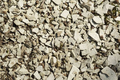 A layer of grey limestone rubble for the background. Stone texture Royalty Free Stock Photography
