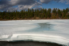 A layer of ice melts from the heat. Royalty Free Stock Photos