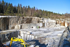 Layer upon layer of granite in a stone quarry. The quarry is located on Ystehede in Halden municipality. Norway. In the quarry the stones are broken for Royalty Free Stock Photography
