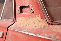 Layer of putty on old car Royalty Free Stock Photo
