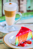 Layer rainbow cakes and cappuccino coffee Stock Photography