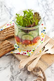 Layer salad in vintage jar Stock Image