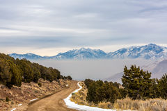 Layer of Smog. Settling over the valley, with a dirt road leading to it. Inversion layer visible. This is the south end of the Salt Lake County. Looking north Royalty Free Stock Photos