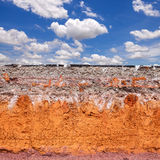 Layer of soil beneath the asphalt road with blue sky Royalty Free Stock Photos