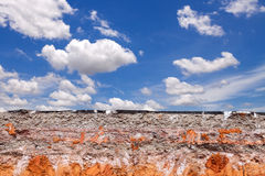 Layer of soil beneath the asphalt road with blue sky Stock Photo