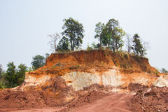 Layer of soil Front loader strips all side of a hill Stock Photo