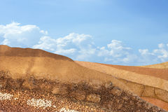 Layer of soil underground on sky background Stock Photography