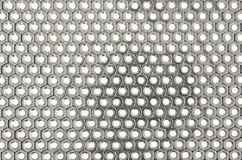 A layer of the stainless screw nuts. A nice layer of  tightly placed stainless screw nuts on the white background Royalty Free Stock Images