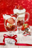 Layer strawberry and chocolate dessert. In glass goblet.  Party dish Royalty Free Stock Images
