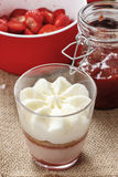 Layer strawberry dessert with whipped cream topping Stock Images
