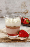 Layer strawberry dessert with whipped cream topping. Festive and party dessert Royalty Free Stock Photography