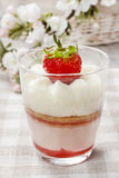 Layer strawberry dessert with whipped cream topping Stock Photo