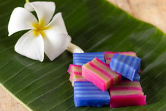 Layer Sweet Cake. Name is Kanom Chan in Thailand. Put on banana leaf with Plumeria flower stock images