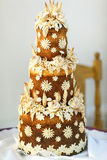 Layered baked bread decorated with fowers Royalty Free Stock Photography