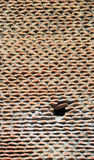 Layered brick support wall. Uneven brick and cement wall created with layered cemented pieces of bricks royalty free stock images