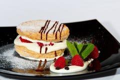 Layered cake with milk cream 1. Layered cake with milk cream, raspberry, chocolate and mint Stock Photo