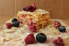 Layered cake Napoleon with berries bluberries and raspberries royalty free stock images