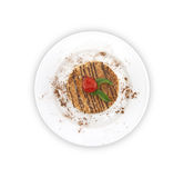 Layered cake with nut on plate, on white background. Top view.  Royalty Free Stock Image