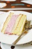 Layered cake with pistachio and raspberry cream Stock Photo