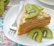 Layered cake with slices of kiwi fruit Stock Images