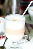 Layered cappuccino in a clear glass mug Royalty Free Stock Photography