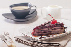 Layered chocolate cake  with  cherries Royalty Free Stock Images