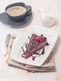 Layered chocolate cake  with  cherries Royalty Free Stock Photo