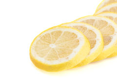 Layered circular slices of yellow lemon. Spread out on a white background stock photo
