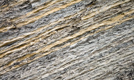 Layered clay texture. Texture of layered clay. Closeup photo of cliff on Black Sea coast Stock Image