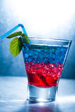 Layered cocktail with blue and red Royalty Free Stock Photo