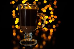 Layered Coffee Cocktail Against Dark Glowing Background Royalty Free Stock Image