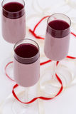 Layered cranberry mousse in glass on white table Royalty Free Stock Image