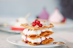 Layered cream dessert Millefeuille with vanilla cream and red berries royalty free stock images