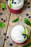 Layered dessert with blueberry mousse and whipped cream, decorat Royalty Free Stock Image