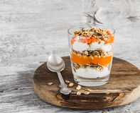 Layered dessert with cream cheese, papaya puree and homemade granola. Stock Image