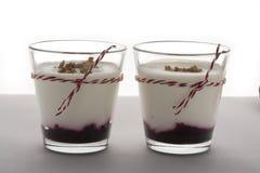 Layered dessert with fruits yogurt and cream cheese in glass jar Stock Image